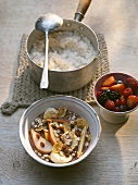 Coconut rice pudding & berry salad, chocolate cream muesli & fruit