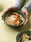 Asian noodle soup with chicken and prawns