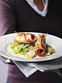 Turkey and ham rolls on kohlrabi and savoy cabbage