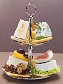Assorted cheese appetisers on tiered stand