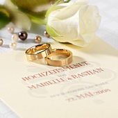 Wedding menu, wedding rings and white rose