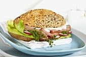 Prosciutto, sheep's cheese, lettuce and cress in bread roll