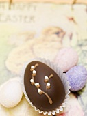 Chocolate Easter egg and sugar eggs