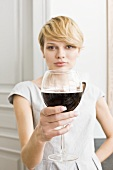 Young woman with a glass of red wine