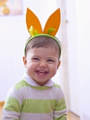Little boy wearing rabbit ears