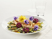 Salmon fillet with asparagus and flowers