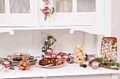 Christmas decorations and biscuits on kitchen cabinet