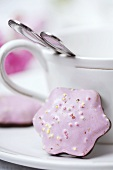 Lebkuchen with pink icing and sprinkles