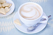 Cappuccino and heart-shaped biscuits