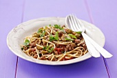 Spaghetti and mince sauce with olives and herbs