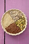 Sunflower seeds, pumpkin seeds, sesame seeds & linseed in a bowl