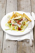 Steamed cod with chilli butter on leeks, potato wedges