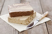 Vanilla and chocolate halva on napkin with knife