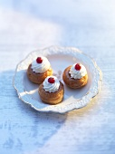 Small babas with cream rosettes and redcurrants