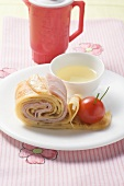 Ham crêpes and tomato snail with tomato stock