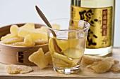 Ginger tea, sake and crystallised ginger