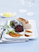Black pudding and white sausage with mashed potato and apple