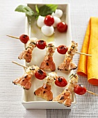 Scampi and cherry tomatoes on wooden skewers