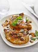 Pork chops with button mushrooms