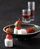Marshmallows and strawberries on cocktail sticks