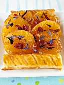 Apricot puff pastry tart with dried flowers