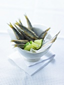 Deep-fried anchovies with lime wedges
