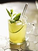 Lemon mint tea in a glass cup (Morocco)