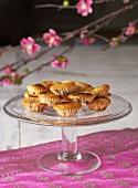 Chocolate chip mini-muffins on cake stand