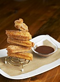 Cinnamon churros with chocolate sauce
