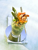 Savoury asparagus smoothie with skewered gamba