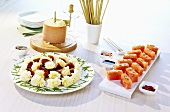Cheese flowers with Bündnerfleisch, salmon sashimi with watermelon