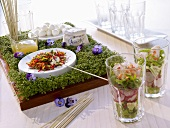 Edible landscape with mozzarella balls, herbs & bed of cress