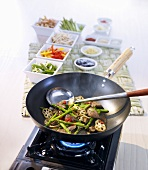 Assorted vegetables and mushrooms in wok