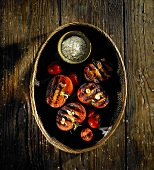 Grilled tomatoes in a basket with salt