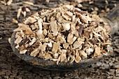 Acorus gramineus root in wooden spoon