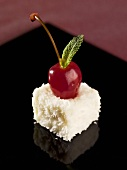 Coconut appetiser with cherry