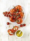 Tomatoes prepared for grilling with olive oil and garlic