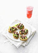 Roast duck, cherries & rocket on crostini, glass of Negroni
