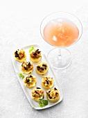Frittata topped with aubergine, a glass of Mai Tai Martini