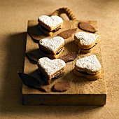 Heart-shaped filled chocolate biscuits