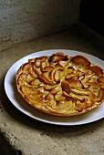 Apple tart on cake plate