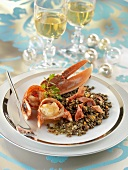 Lobster medallions on lentils with ham crisps