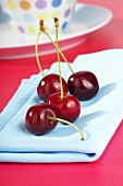 Cherries on blue napkin