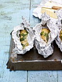 Baked potatoes with herbs, butter