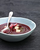 Beetroot soup with potatoes and radishes