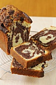 Marble cake, partly sliced on a cake rack