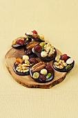 Mendiants with nuts & dried fruit (Chocolate discs, France)