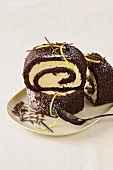 Slices of chocolate Swiss roll with lemon curd filling