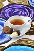 A cup of tea with Viennese fingers and chocolate cookies