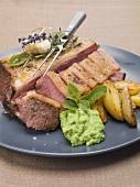 Roast lamb with pea puree and roasted potatoes